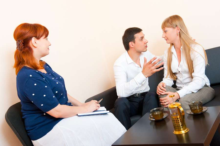 Couple going through a family mediation session